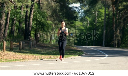 Young fitness woman jogging in the city park.	 #661369012