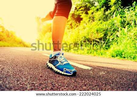 young fitness woman legs running at forest trail  #222024025