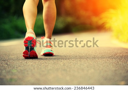 young fitness woman legs running at forest trail  #236846443