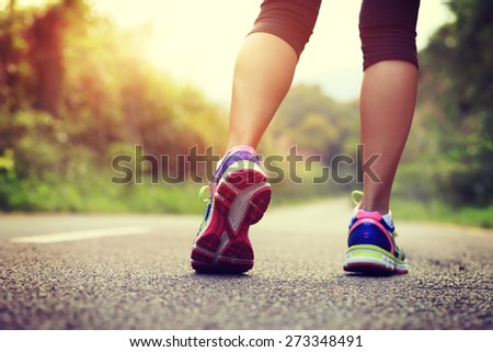 young fitness woman legs running at forest trail  #273348491