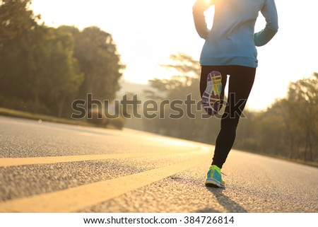 young fitness woman runner athlete running at road #384726814