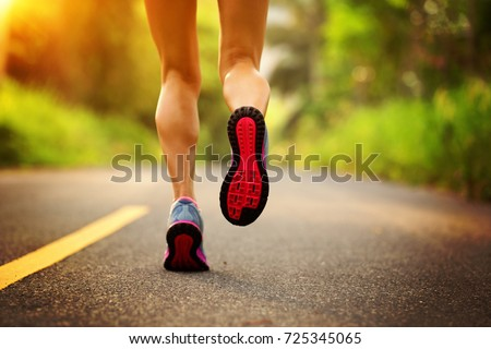 young fitness woman runner running on the forest trail #725345065