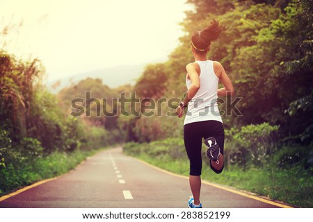 young fitness woman runner running on trail #283852199