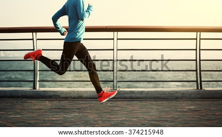 young fitness woman running at seaside #374215948