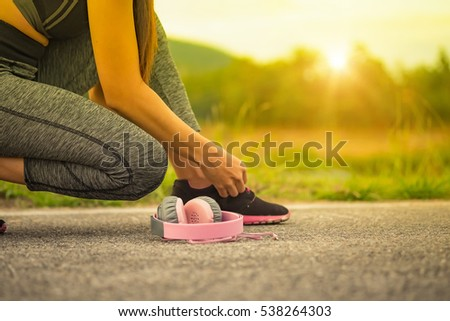 Young fitness woman running in sunset nature, healthy lifestyle concept.
