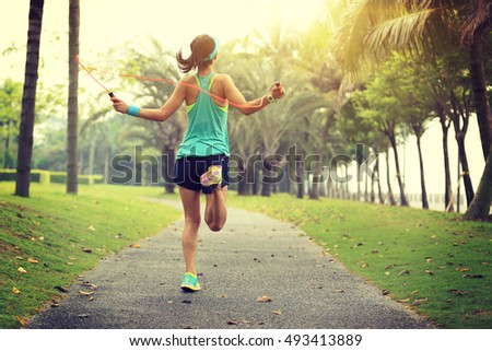 young fitness woman skipping...