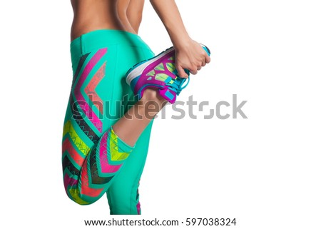 young fitness woman stretching legs before run