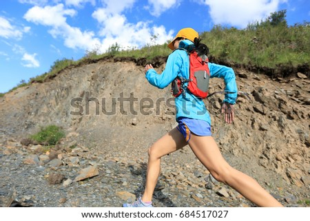 young fitness woman trail runner running in the nature #684517027