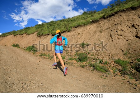 young fitness woman trail runner running in the nature #689970010