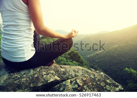 young fitness yoga woman at mountain peak #526917463