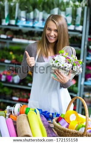 Young florist shop flowers