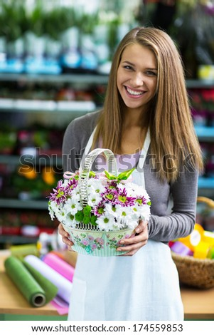Young florist with a basket of flowers