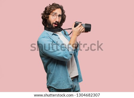 young fool man with a photo camera