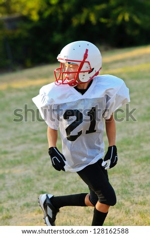 Young football player going out for a pass.