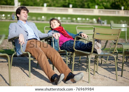 Young french couple relaxing in the Luxembourg Garden of Paris