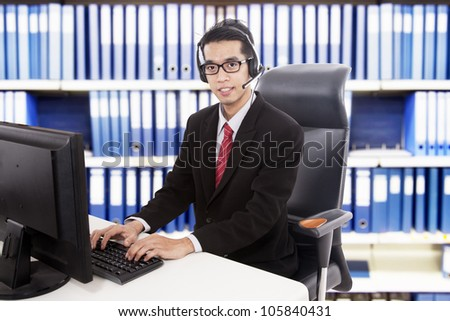 Young friendly customer service working at office
