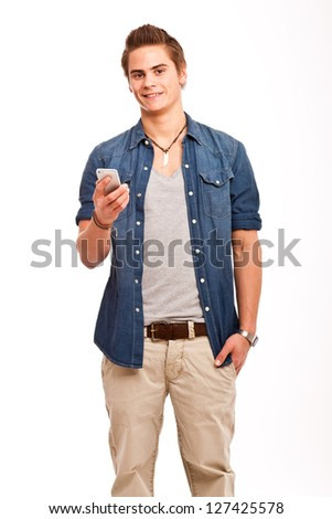 young, friendly guy holding his cellphone