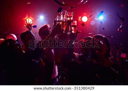 Young friendly people toasting in night club #351380429