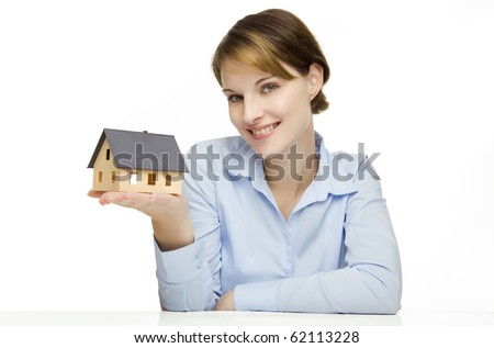 young friendly smiling businesswoman presenting a model house