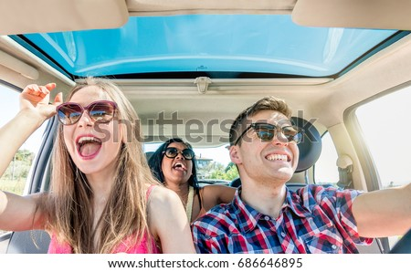 young friends fun inside car laughing singing in group and driving. \' -Document Title=\'young friends fun inside car laughing singing in group and driving