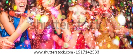Young friends having party throwing confetti - Young people celebrating on weekend night - Entertainment, fun, new year's eve, nightlife, holidays, concept - Focus on red hair girl hands #1517142533