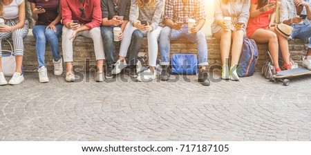 Young friends using smartphones and drinking coffee outdoor - Group of people having fun with technology trends - Youth, new generation addiction and friendship concept - Main focus on center guys