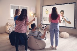 Young friends watching sports at home
