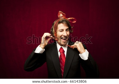 young funny guy with red ribbon on the head