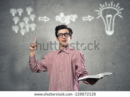 Young funny man in casual with book in hand