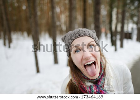 Young funny woman being silly on winter