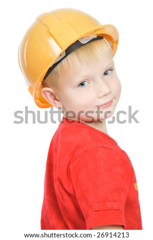 Young future engineer in helmet, isolated on white