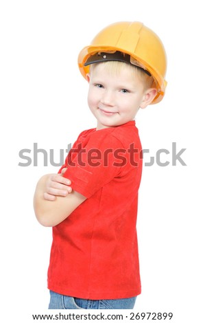 Young future engineer in yellow helmet, isolated on white