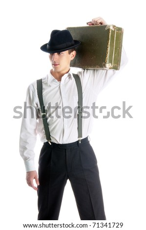 young gangster man holding an old suitcase on white background