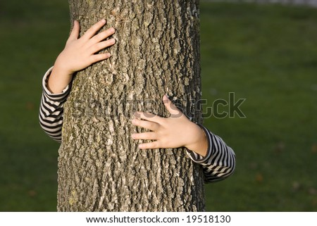 young generation embracing nature, with a hug at a tree