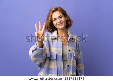 Young Georgian woman isolated on purple background happy and counting three with fingers Photo stock ©