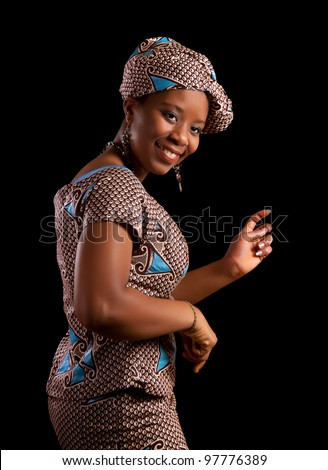 Young Ghanese african woman showing a dance in her traditional national costume