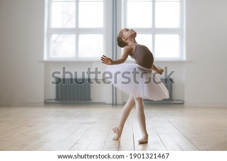 Young gifted dancer in tutu dress studying ballet dance in dance school Stockfoto ©