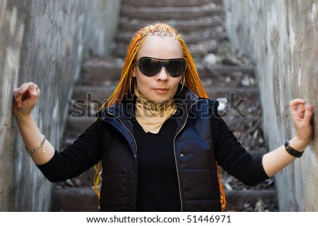 Young ginger caucasian girl with red dreadlocks