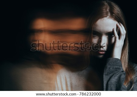 Young girl addicted to drugs with hallucinations against blurred background