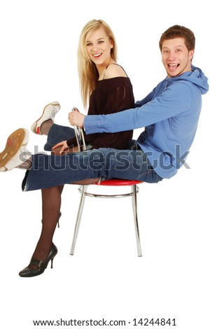 Young girl and a guy sitting on a chair together. isolated on white