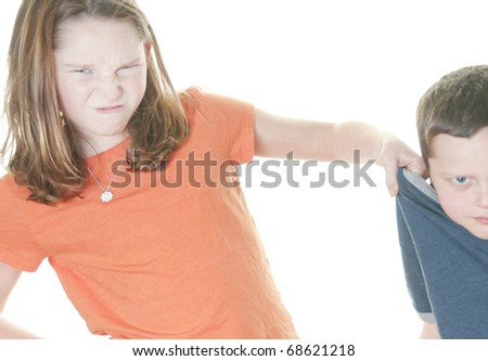 Young girl and boy in fight