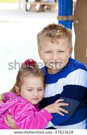 Young  girl and boy (sister and brother) in the children's park