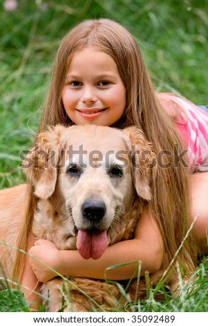 Young girl and dog - golden retriever