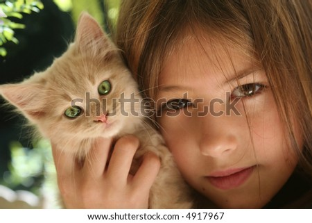 Young girl and green eyed cat - focus soft