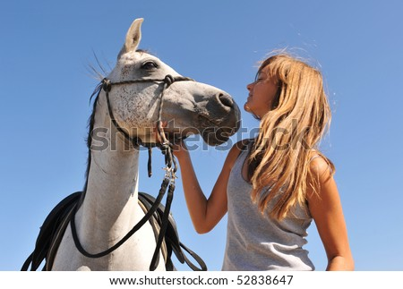 young girl and her best friend arabian horse