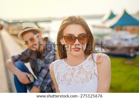 young girl and her boyfriend in the background. Young couple