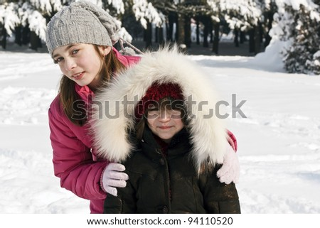 Young girl and her sister at winter day