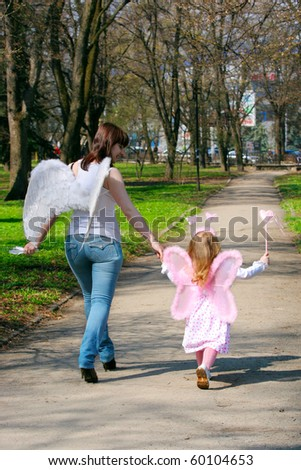 young girl and mother with wings