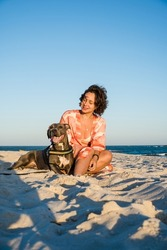 Young girl and pit bull dog in a moment of affection on the beach of Saquarema in Rio de Janeiro. Sunset.