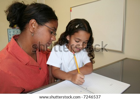 Young girl and teacher at computer